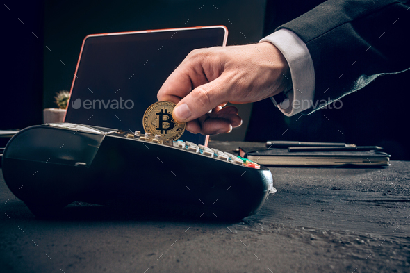 Bitcoin, credit card and POS-terminal - Stock Photo - Images