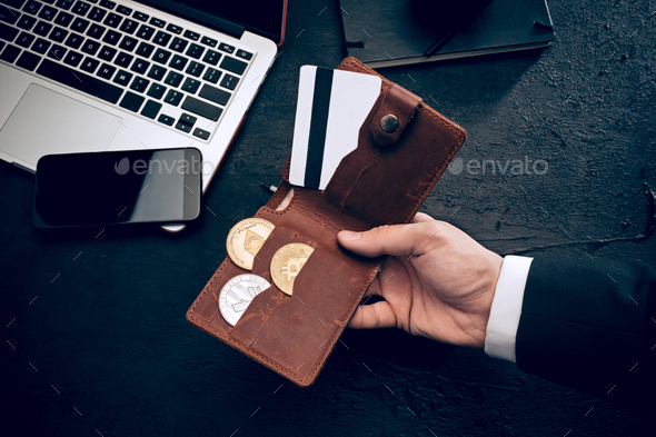 The golden bitcoin in mail hands - Stock Photo - Images