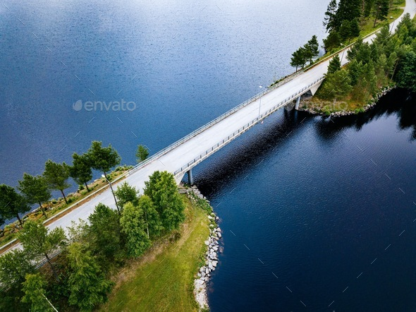 Aerial view of bridge road near blue lake in summer landscape in Finland - Stock Photo - Images