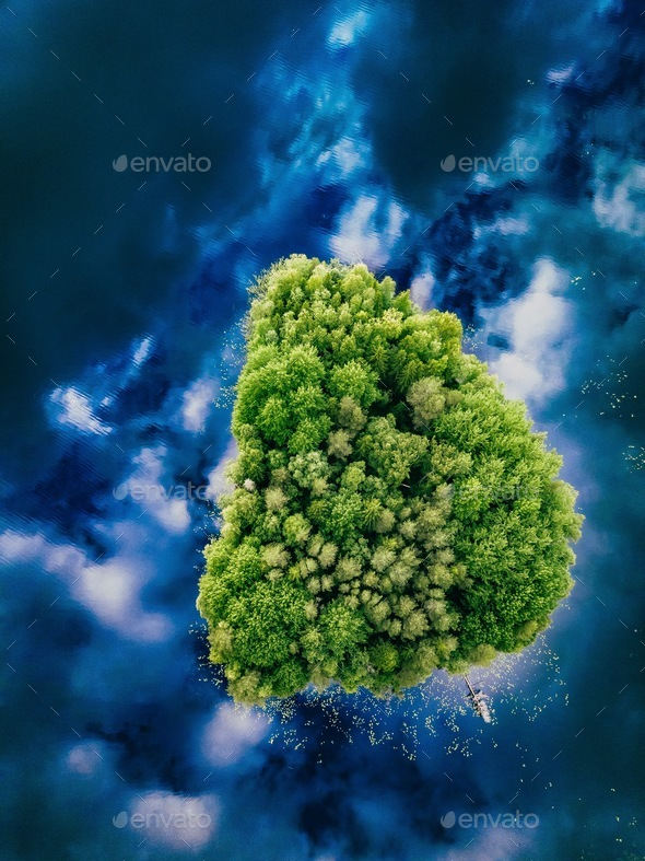 Aerial view over the small green forest island in blue lake in Finland - Stock Photo - Images