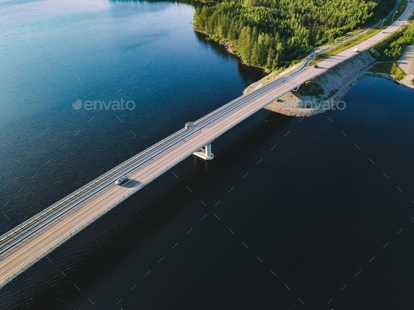 Aerial view of bridge across blue lake in summer landscape in  Finland - Stock Photo - Images