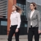 Business Women Walking Against a Modern Office Building - VideoHive Item for Sale