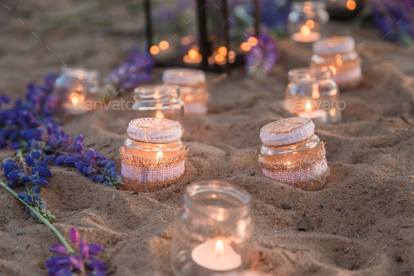 Romantic jars full of candles - Stock Photo - Images