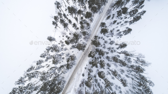 Aerial drone view of road in idyllic winter landscape - Stock Photo - Images