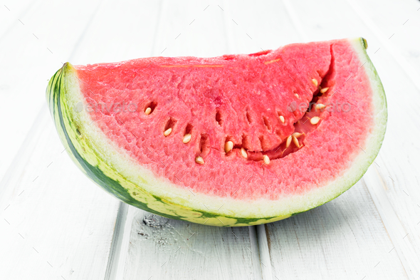 half watermelon on white wooden board - Stock Photo - Images