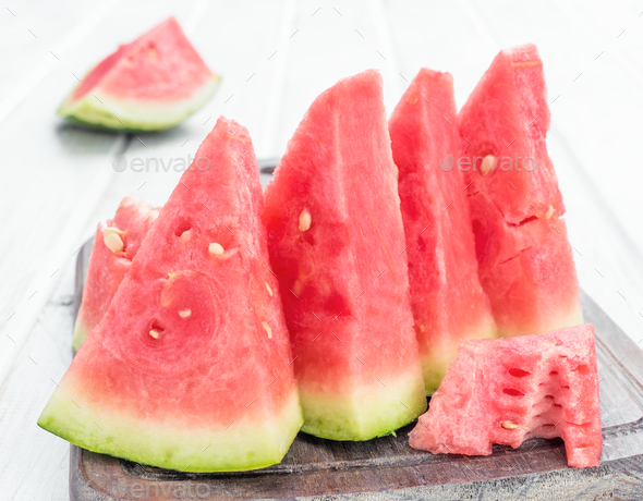 lots of watermelon on white wooden board - Stock Photo - Images