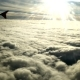 Airplane Flying High Among Clouds and Sunlight - VideoHive Item for Sale