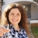 Happy Young Woman Moving Into New Home. Showing Keys of New Property - VideoHive Item for Sale