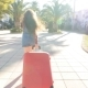 Toung Woman with a Red Suitcase Running on a Resort - VideoHive Item for Sale