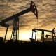 Working Oil Pump Jacks Against Sunset Cloudscape - VideoHive Item for Sale