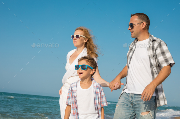 Father mother and  son  playing on the beach at the day time. - Stock Photo - Images