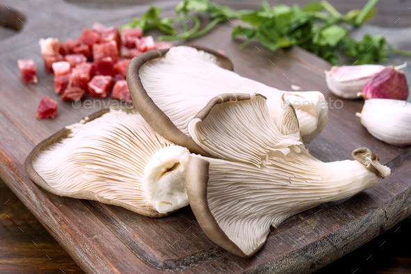 raw mushrooms on kitchen table - Stock Photo - Images