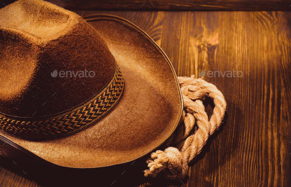 cowboy hat on wood - Stock Photo - Images