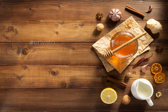 glass jar of honey on wood - Stock Photo - Images