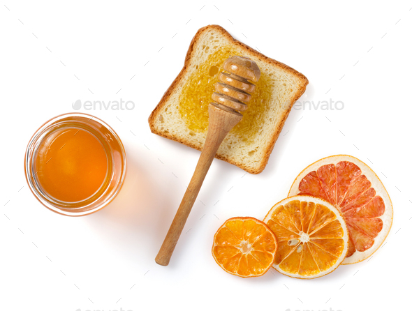 glass jar of honey and bread on white - Stock Photo - Images