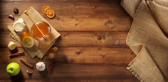 glass jar of honey on wood - Stock Photo - Images
