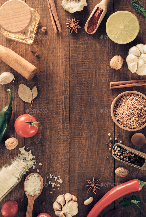 herbs and spices on wood background - Stock Photo - Images
