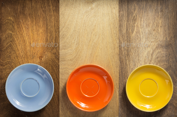 empty saucer at wooden background - Stock Photo - Images