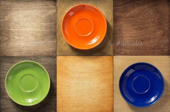 empty  saucer at wooden table - Stock Photo - Images
