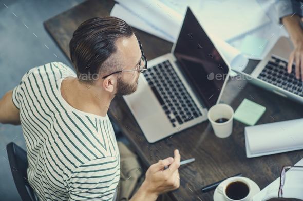 Young hipster at work - Stock Photo - Images
