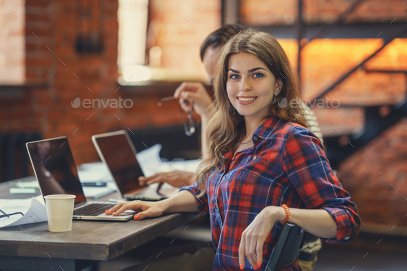 Attractive girl at work - Stock Photo - Images