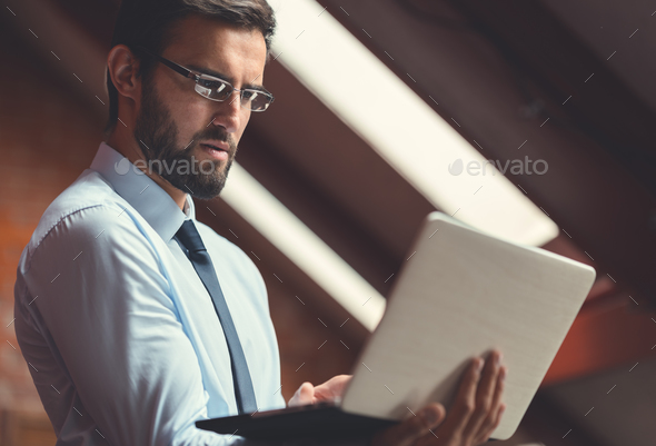 Businessman in the loft - Stock Photo - Images