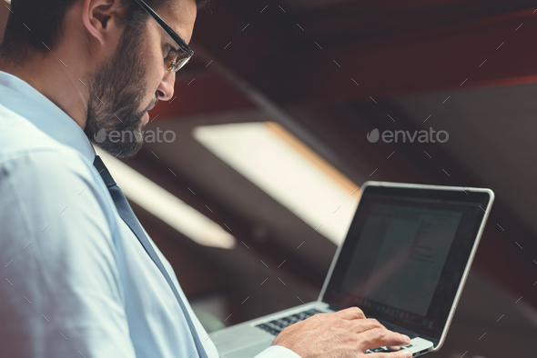 Young man with laptop - Stock Photo - Images
