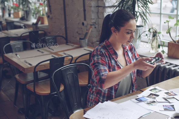Young woman in cafe - Stock Photo - Images