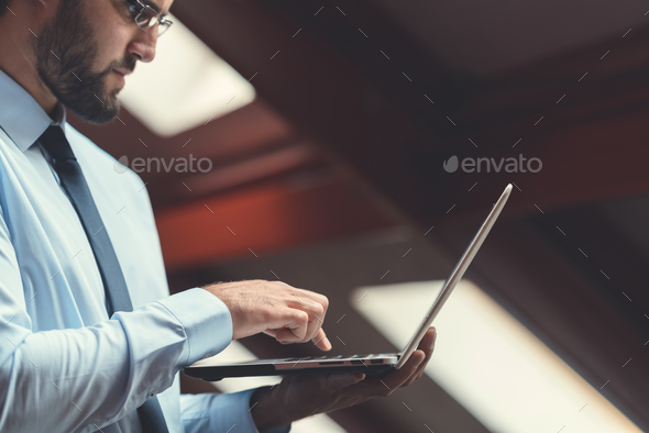 Businessman with laptop - Stock Photo - Images