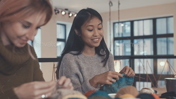 Knitting girls in studio - Stock Photo - Images