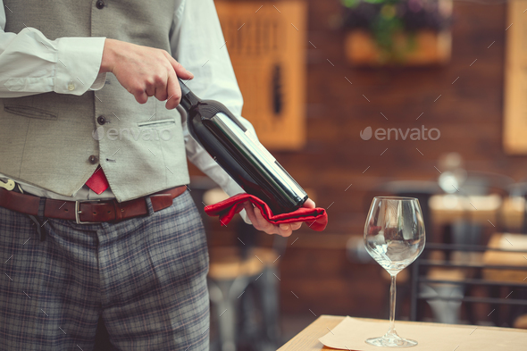 Man with a bottle of wine - Stock Photo - Images