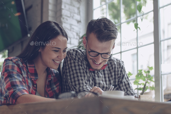 Smiling couple indoors - Stock Photo - Images