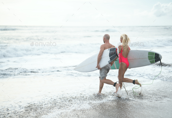 Young couple on the beach - Stock Photo - Images
