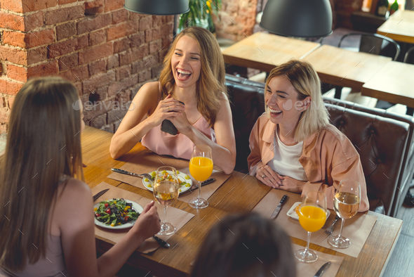 Smiling girls in cafe - Stock Photo - Images