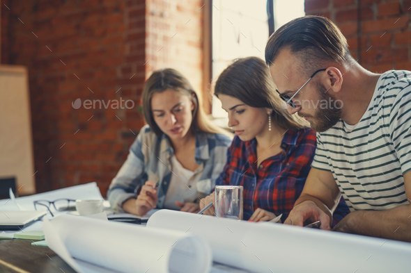 Teamwork in the loft - Stock Photo - Images