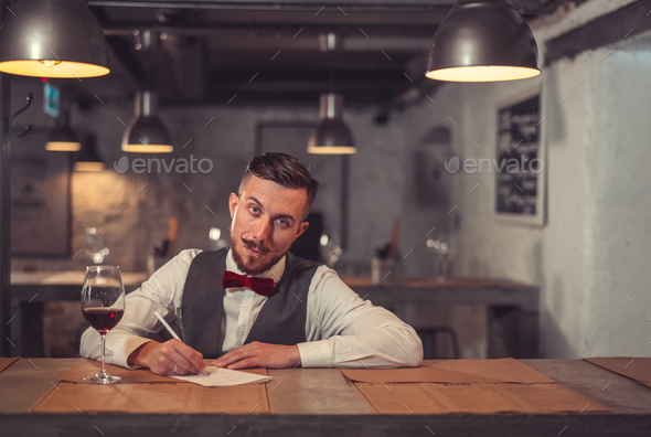 Writing man indoors - Stock Photo - Images
