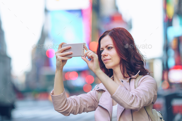Traveling photographer in Manhattan - Stock Photo - Images