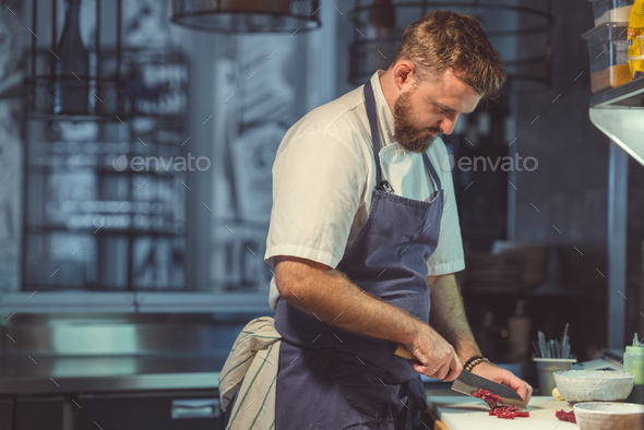 Young cook in the kitchen - Stock Photo - Images