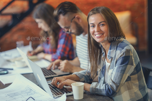 Smiling girl with laptop - Stock Photo - Images