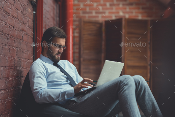 Working businessman indoors - Stock Photo - Images