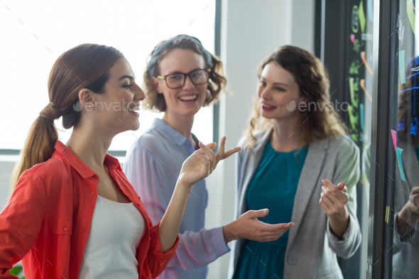 Business executives discussing with each other in office - Stock Photo - Images