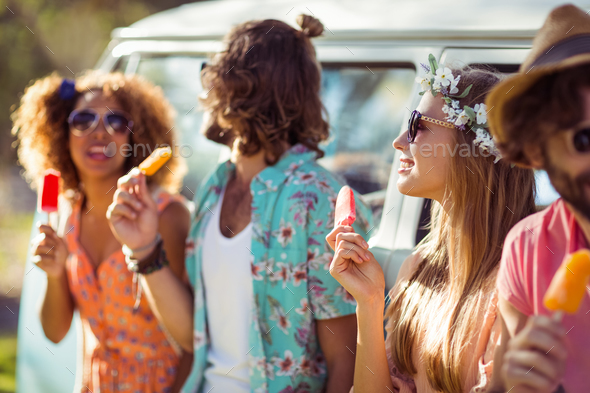 Group of friends enjoying and eating ice lolly - Stock Photo - Images