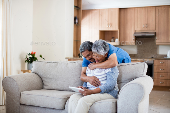 Happy senior couple using digital tablet - Stock Photo - Images