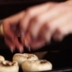 Woman Puts Mushrooms on Baking Sheet in Kitchen - VideoHive Item for Sale