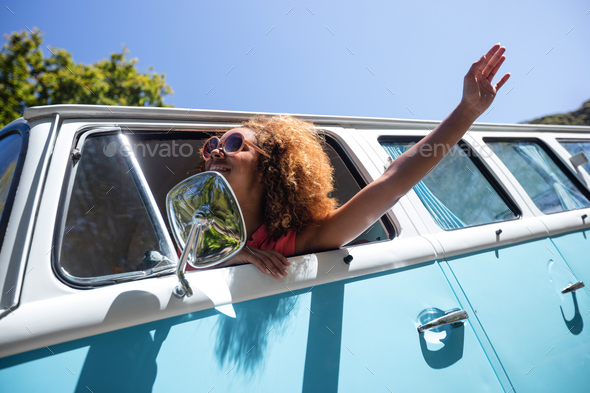 Woman looking out of camper van window - Stock Photo - Images
