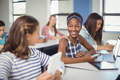 Students interacting with each other in classroom - PhotoDune Item for Sale