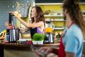 Shop assistant preparing juice at health grocery shop - PhotoDune Item for Sale