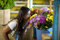 Woman smelling a bunch of flowers - PhotoDune Item for Sale