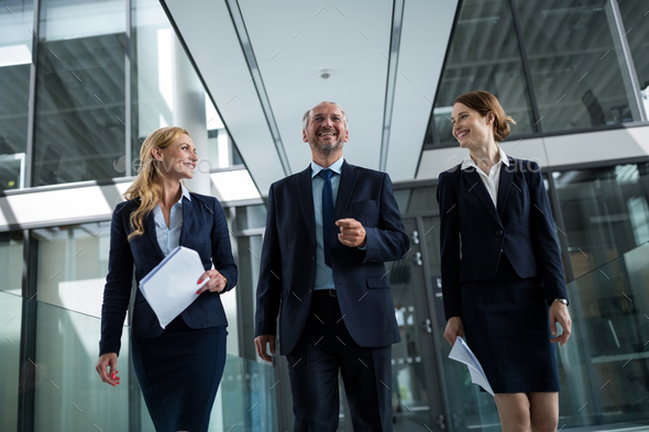 Businesspeople walking in the office - Stock Photo - Images