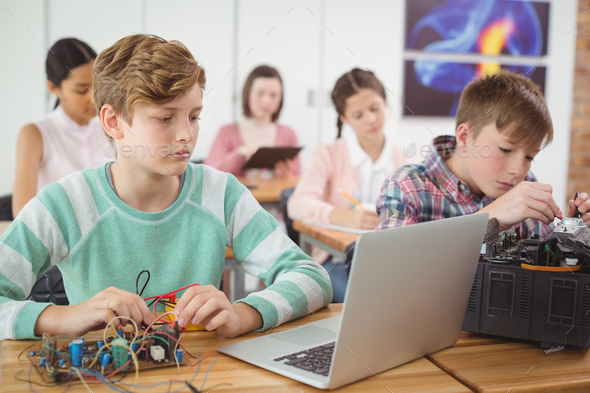 Schoolboys working on electronical project in classroom - Stock Photo - Images